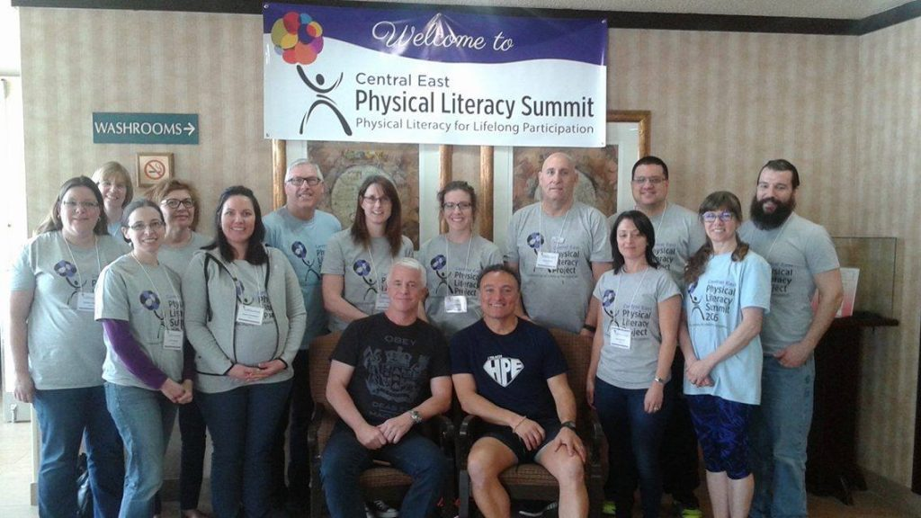 Central East Physical Literacy Summit-group in front of banner